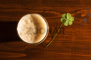 Pint of black beer and a shamrock