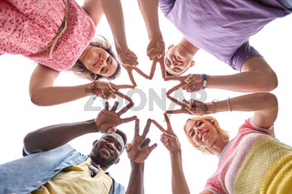 group of happy friends showing peace hand sign
