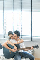 Couples playing guitar