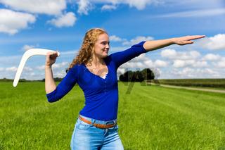 Young dutch woman throwing boomerang