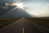 Supercell Storm Blocks out the Sun Rural Road Highway