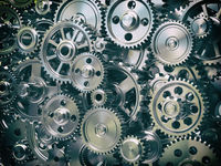 Engine gear wheels. Industrial and teamwork concept background.