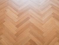 wooden floor - herringbone parquet closeup - oak parquet -