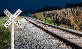Oncoming train with railroad crossing sign