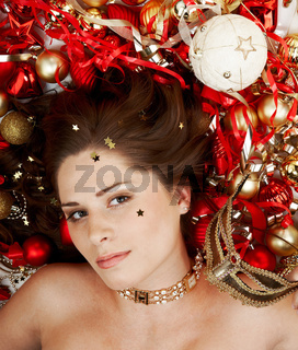 Beautiful brunette lying among Christma decoration