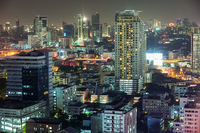 Asian downtown night scene, beautiful modern buildings, bright glowing lights
