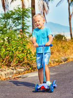 Child riding scooter