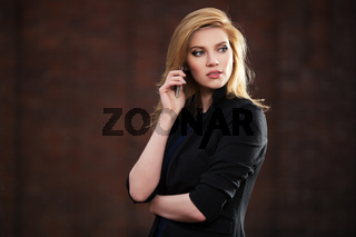 Young fashion blond business woman calling on cell phone outdoor