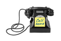 Vintage telephone and paper Call home