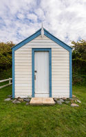 Colorful beach side huts on Devon coast of England
