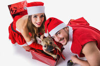 Good looking couple in Santa Claus hat with Christmas gift