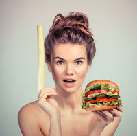 Woman with vegetable hamburger