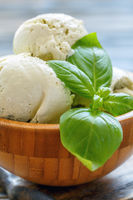 Delicious basil ice-cream in a wooden bowl.