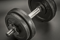 exercise concept - iron dumbbell abstract