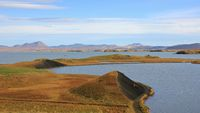 Lake Myvatn and volcanic landscape. Late summer day in Iceland.