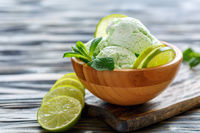 Bowl with homemade ice cream from mint and lime.