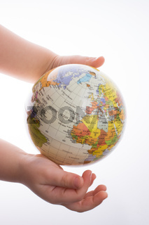 Child holding a globe in his hand