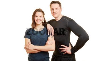 Zwei lächelnde Sportler als Personal Trainer