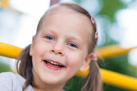 Happy young girl close up portrait outdoors