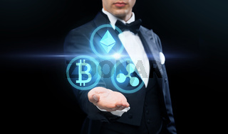 man in tailcoat with cryptocurrency holograms