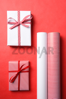 Two Wrapped Christmas presents with matching paper