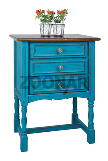 Vintage turquoise commode (Chest of Drawers) with 3 drawers with brass fittings and flower planter isolated on white background including clipping path