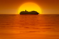 a cruise ship in front of the sunset sky