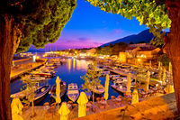 Town of Bol on Brac island harbor at sunset view