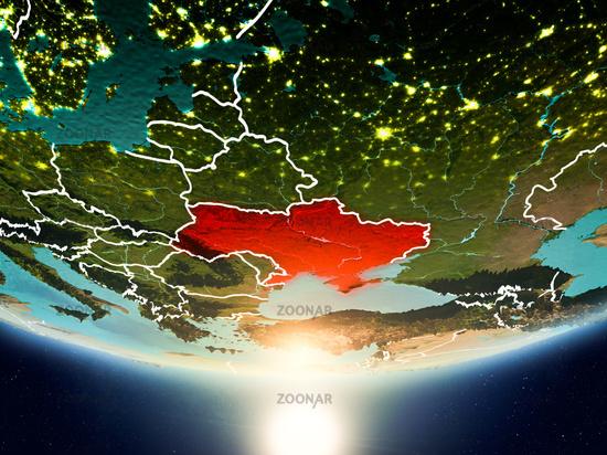 Ukraine with sun on planet Earth