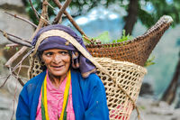 Woman in blue with basket in Nepal