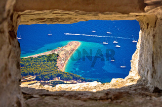 Zlatni rat beach aerial view through stone window