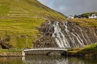 Village and beautiful waterfall landscape of Faroe Islands, Denmark
