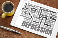 depression word cloud on tablet with coffee