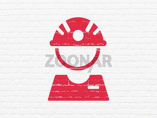 Manufacuring concept: Factory Worker on wall background