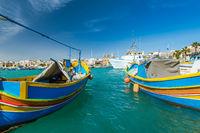 Beautiful colorful fishing boats in Marsaxlokk harbour,Malta