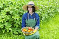 Female gardener with vegetables