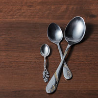 three spoons on a wooden background