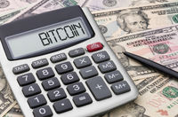 Calculator with dollar bills - Bitcoin