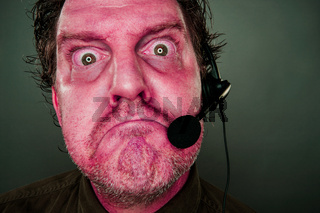 Grumpy Red Eyes and Face Customer Support Man with Headset