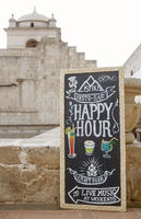 AREQUIPA, PERU - JANUARY 07, 2017: Happy hour board with text written in chalk Arequipa, Peru
