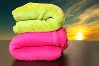colorful towels prepared for sunset bath in the sea