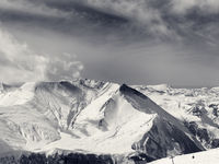 Black and white panorama of winter snowy mountains
