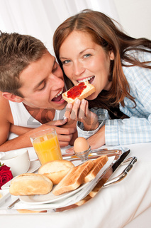 Young happy couple having luxury breakfast