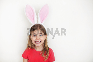 Happy little girl wearing funny bunny ears