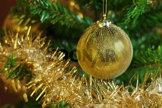 Christmas decoration on the tree with gold chain