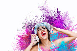 Happy young woman listening music in headphones