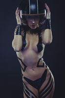 Protective, woman with motorcycle helmet, naked girl dressed with black ribbons by the body. concept speed and security