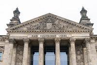 German inscription Dem Deutschen Volke, meaning To The German People, on the portal of Bundestag or Reichstag building in Berlin, Germany