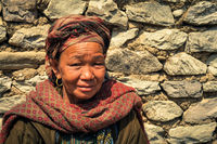 Old woman with big earring in Nepal