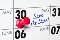 Wall calendar with a red pin - May 30